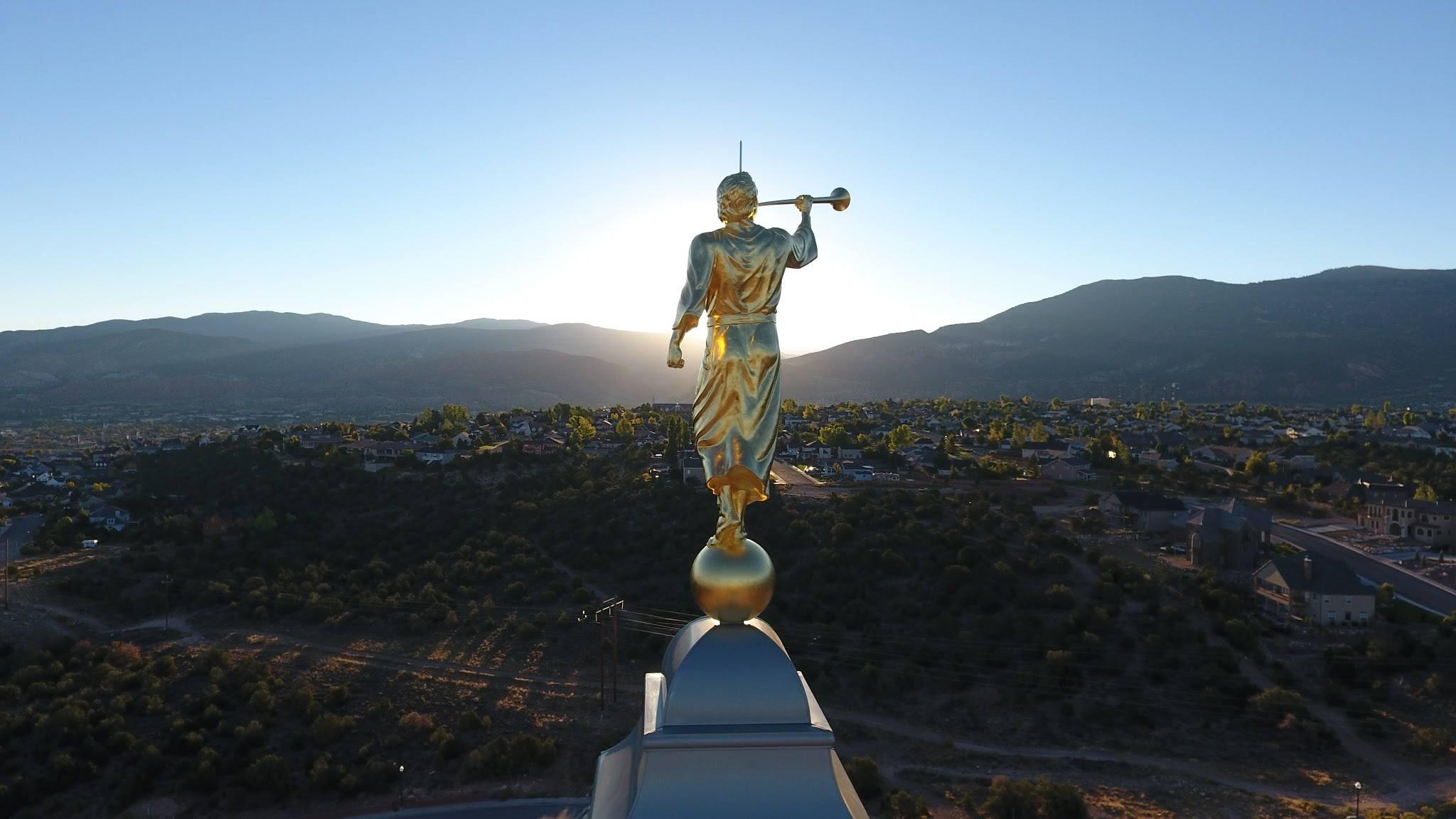 angel moroni on the cedar city temple during the sunrise