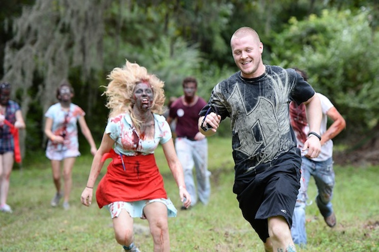 People running away scared from zombies