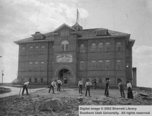 Building_exterior_Old_Main_students_in_front_working